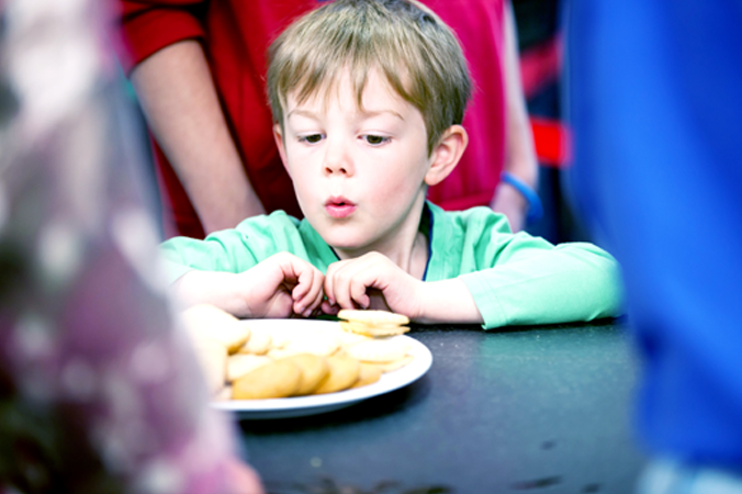 Child looking at biscuits